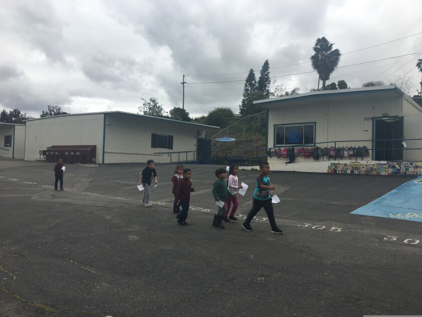 Students walk past portable classrooms at Beaumont Elementary slated for replacement under Vista's $247 school bond.