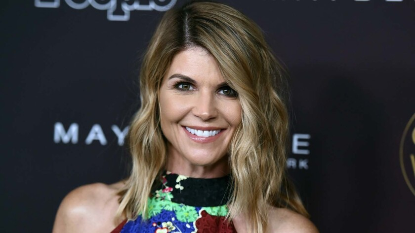 Lori Loughlin and her husband, Mossimo Giannulli, were newly charged in an indictment returned by a grand jury in Boston.