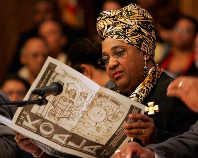 Shirley Weber of SDSU's Africana studies program, read a copy of the UCSD newspaper The Koala during a March 3 forum at Mount Erie Baptist Church.