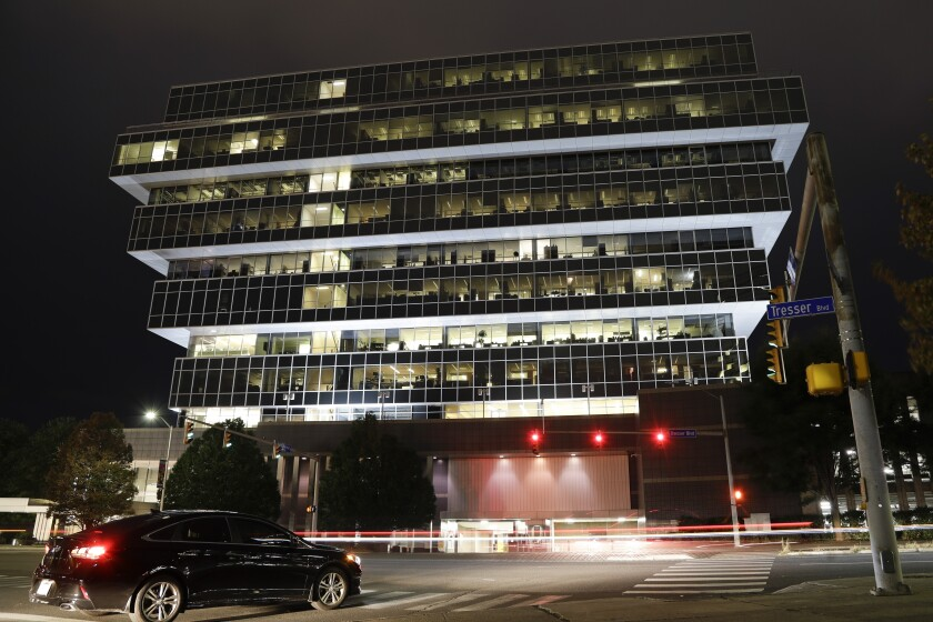 Cars pass Purdue Pharma headquarters in Stamford, Conn., in September 2019.