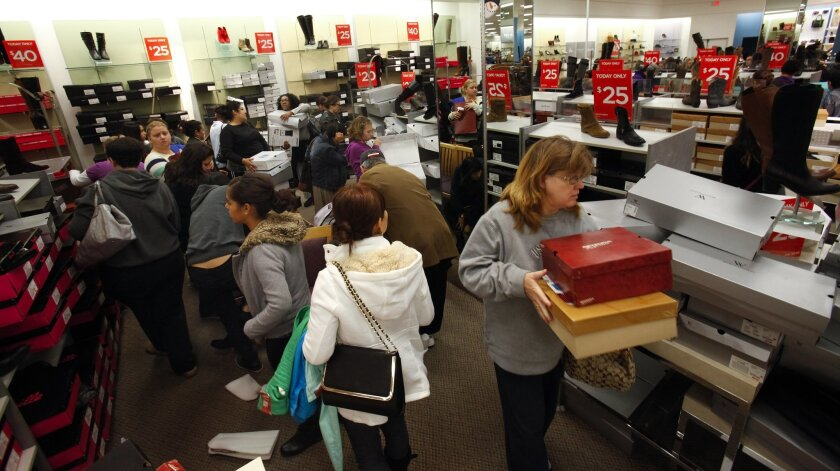 San Diego shoppers filled stores on Black Friday 2012. This year, most shoppers say they'll be staying home.