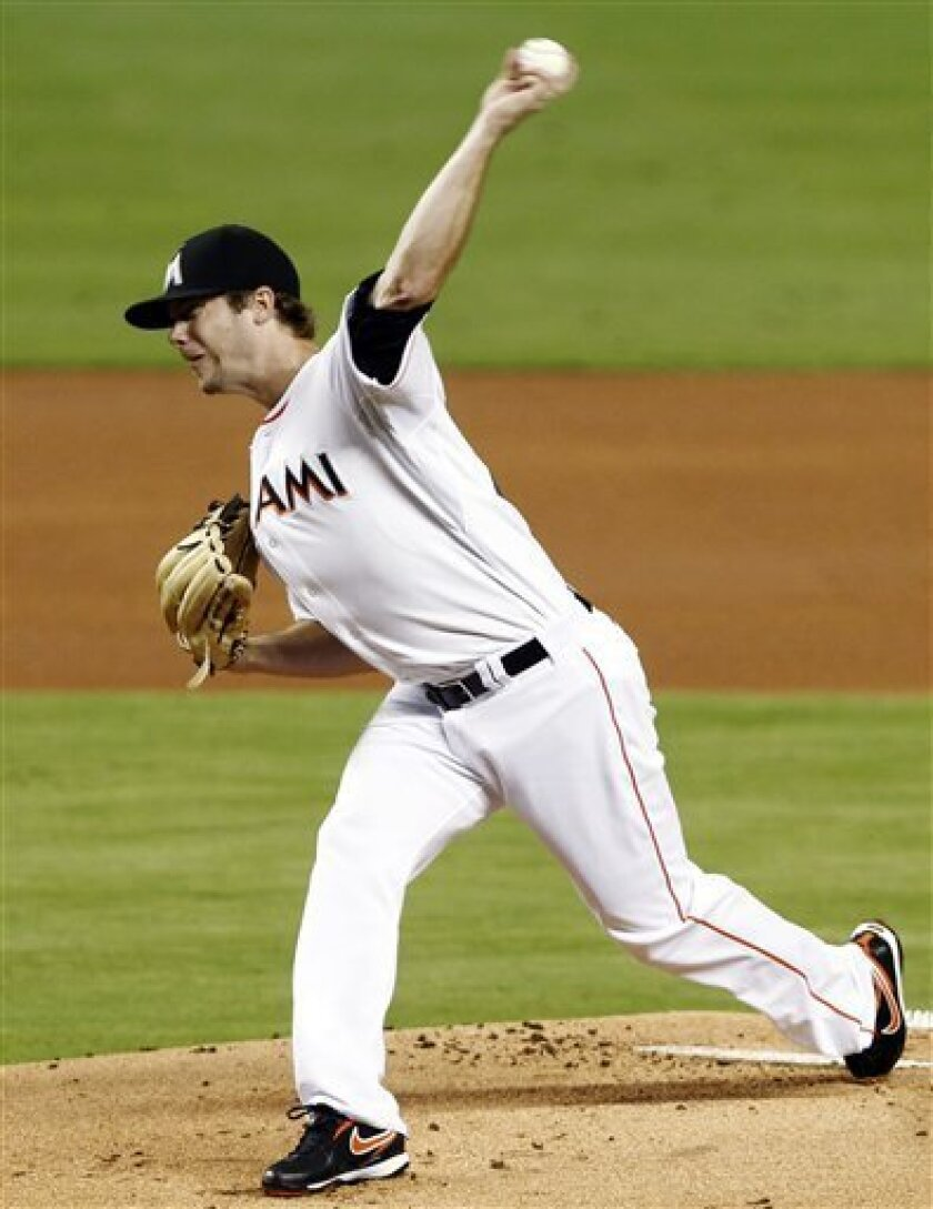 Miami Marlins' Wade LeBlanc pitches to the New York Mets in the first inning of a baseball game in Miami, Monday, Oct. 1, 2012. (AP Photo/Alan Diaz)