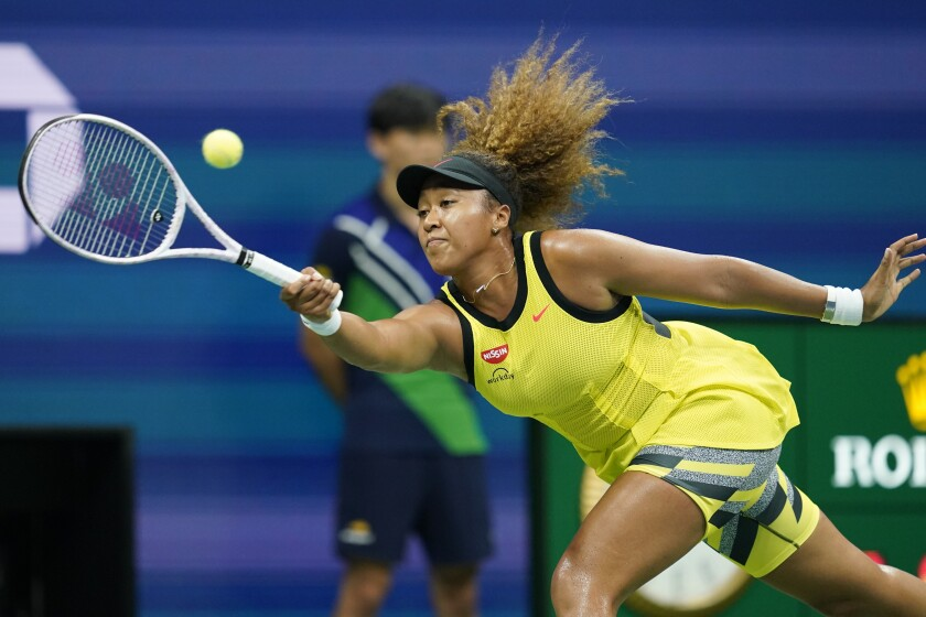 Naomi Osaka returns a shot to Marie Bouzkova during the first round of the US Open.