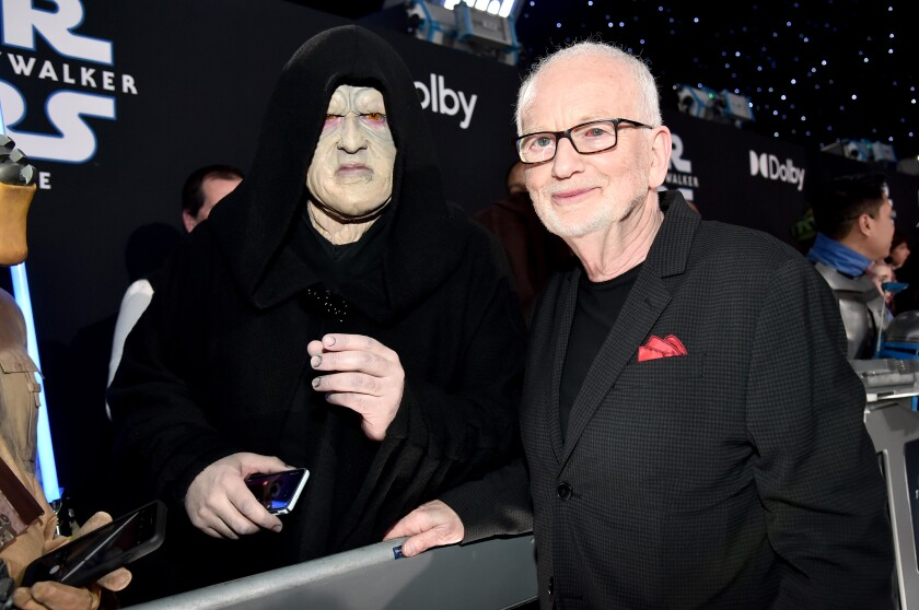 Ian McDiarmid poses with a Palpatine cosplayer at 'The Rise of Skywalker' world premiere