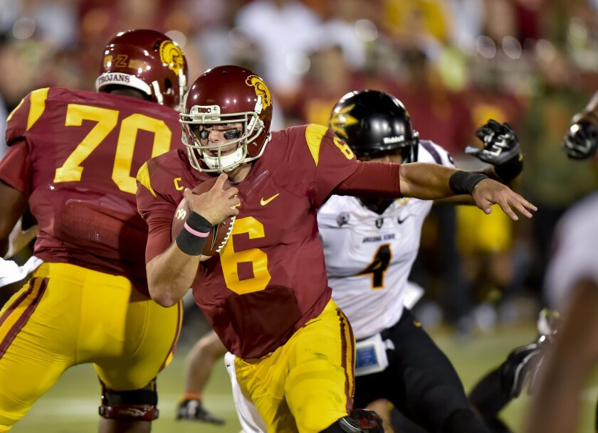 Southern California quarterback Cody Kessler (6) takes the ball in for a touchdown during the second half of an NCAA college football game against Arizona State, Saturday, Oct. 4, 2014, in Los Angeles. Arizona State won 38-34. (AP Photo/Gus Ruelas)