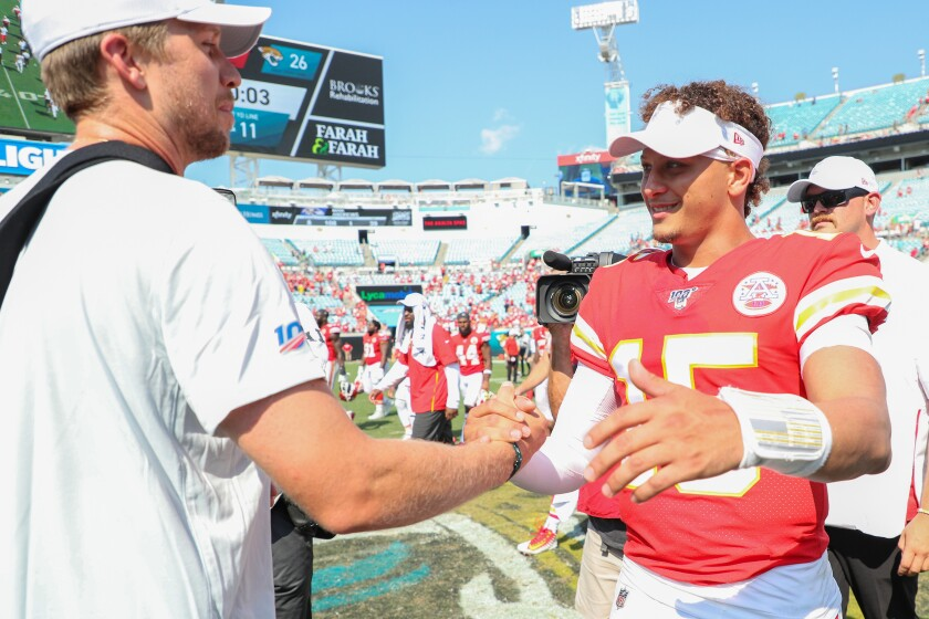 Jacksonville's Nick Foles meets with Kansas City's Patrick Mahomes after game Sunday.