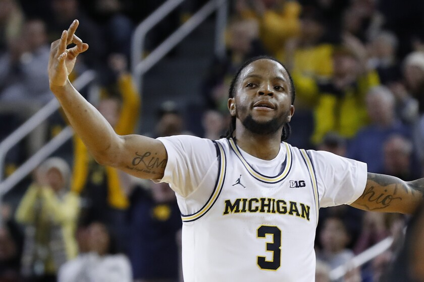 Michigan guard Zavier Simpson celebrates a 3-point basket against Purdue in the second overtime during an NCAA college basketball game in Ann Arbor, Mich., Thursday, Jan. 9, 2020. Michigan won 84-78. (AP Photo/Paul Sancya)