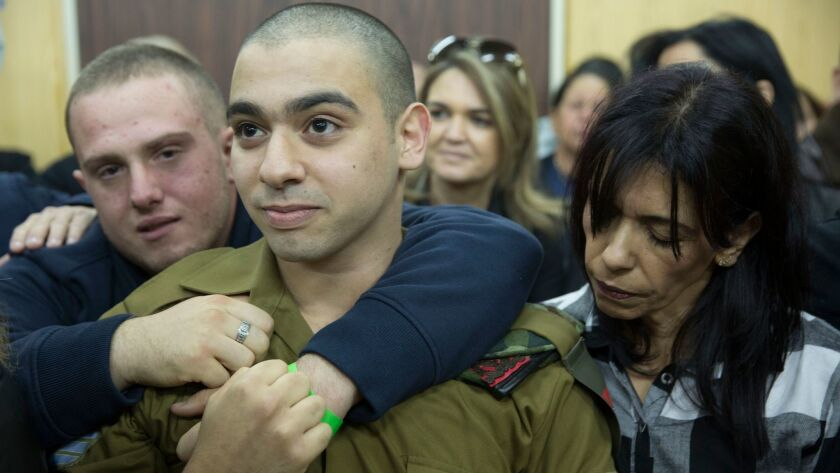 Israel Defense Forces Sgt. Elor Azaria with his parents in military court in Tel Aviv on Jan. 4, 2017.