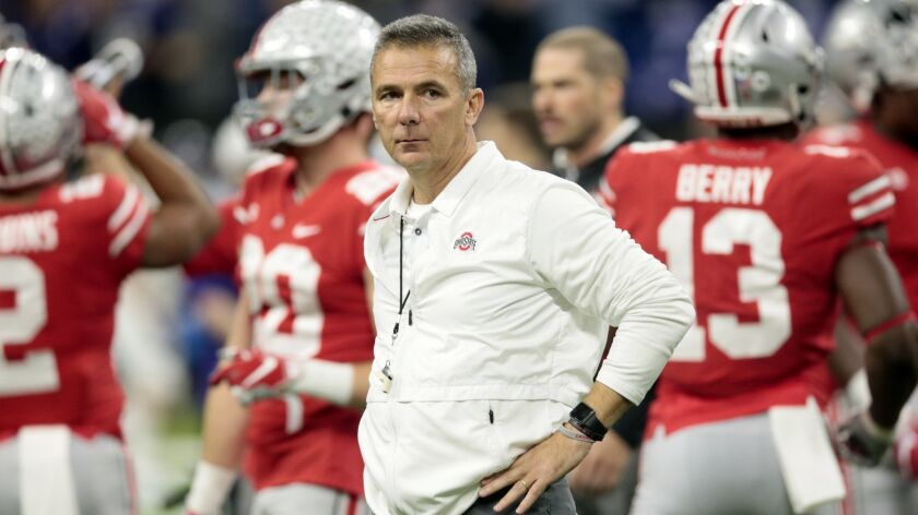 Ohio State head coach Urban Meyer watches during his team warm up before the Big Ten championship NC