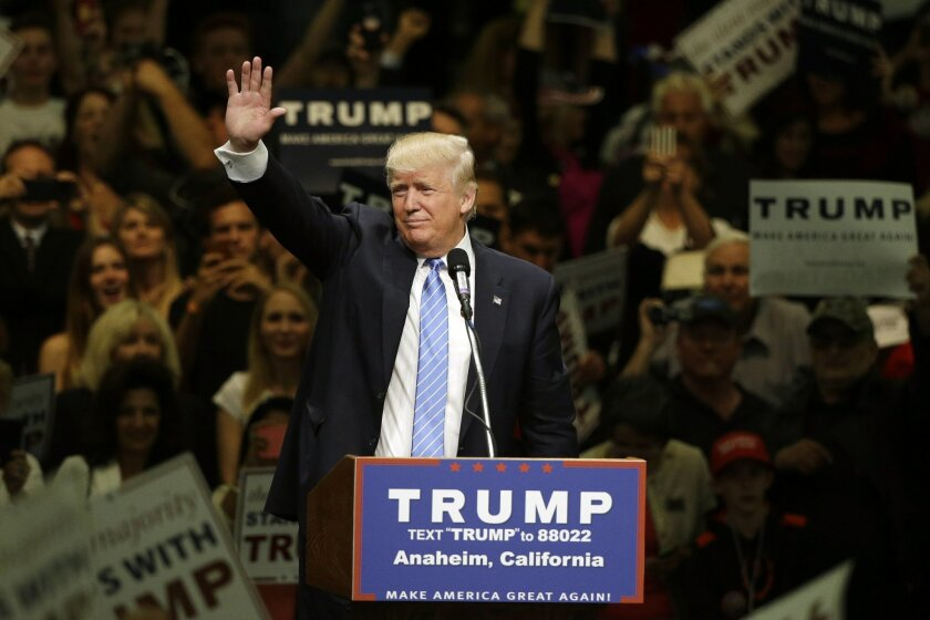 FILE - In this May 25, 2016 file photo, Republican presidential candidate Donald Trump waves toward the crowd after speaking at a rally at the Anaheim Convention Center, in Anaheim, Calif. Two California cities are gearing up for visits by Trump and the possibility of protests, following similar ev