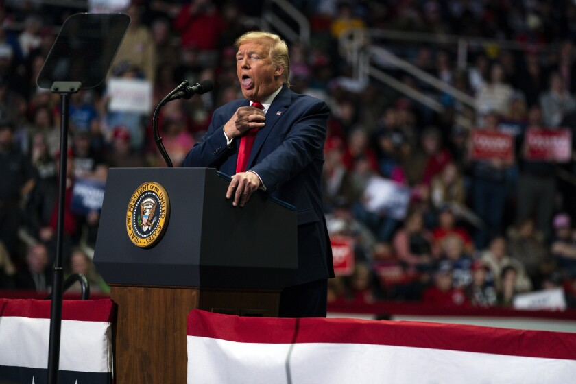 In this March 2, 2020, photo, President Donald Trump makes a joke as he speaks during a campaign rally at Bojangles Coliseum in Charlotte, N.C. The Trump show has a consistent script, with villains, nicknames, grievances and the same hero: himself. At raucous rallies, mostly in states friendly to him, the president tells audiences he could be presidential if he chose to be, even Lincolnesque. (AP Photo/Evan Vucci)