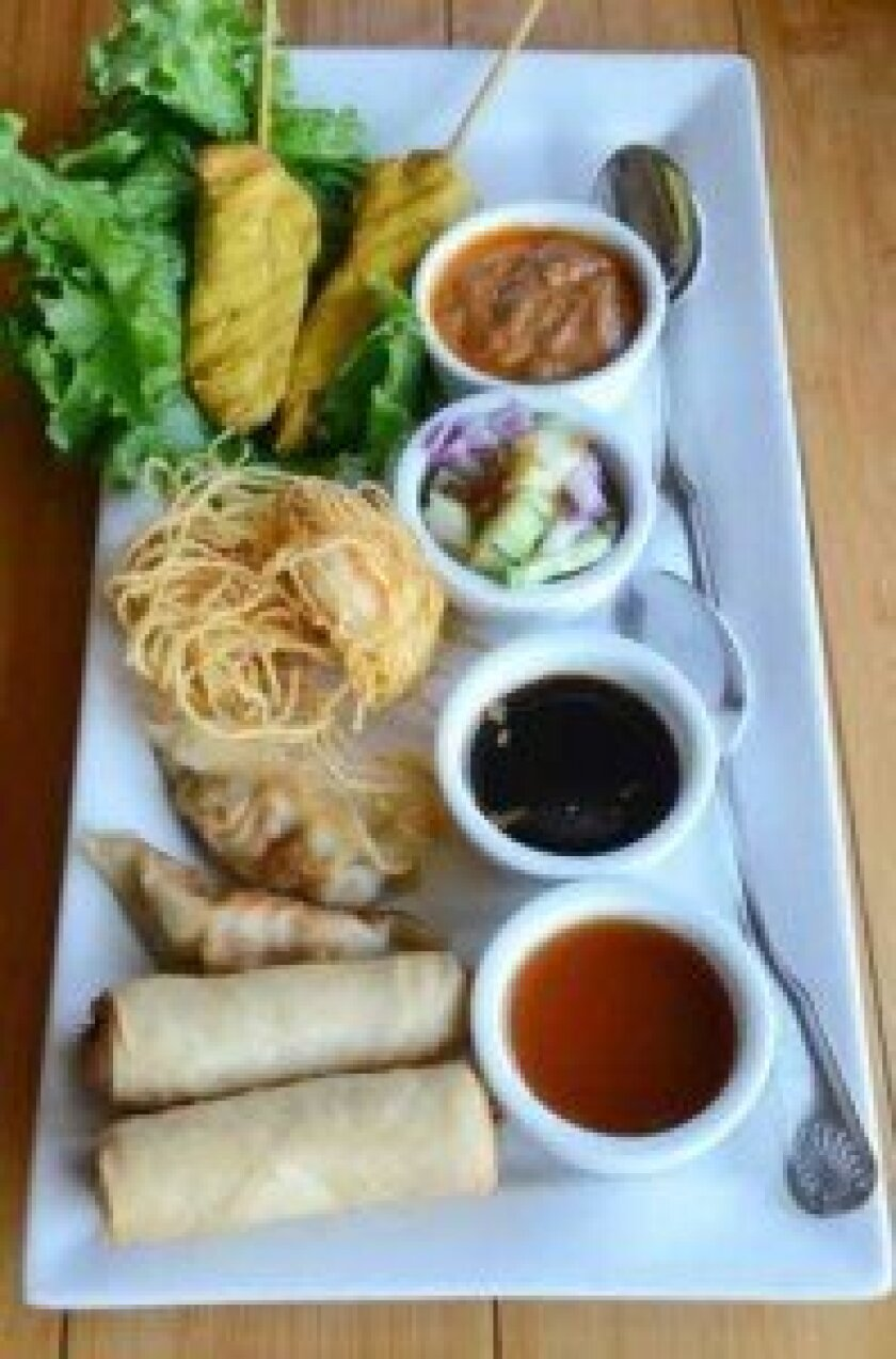 The Samplers Starter consists of Fried Spring Rolls, Gyoza, Shrimp Sarong and Chicken Satay. Photos by Kelley Carlson