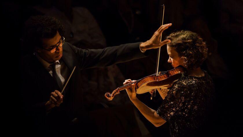 Conductor Jonathon Heyward and violin soloist Hilary Hahn perform Leonard Bernstein's Serenade with the Los Angeles Philharmonic in Walt Disney Concert Hall.