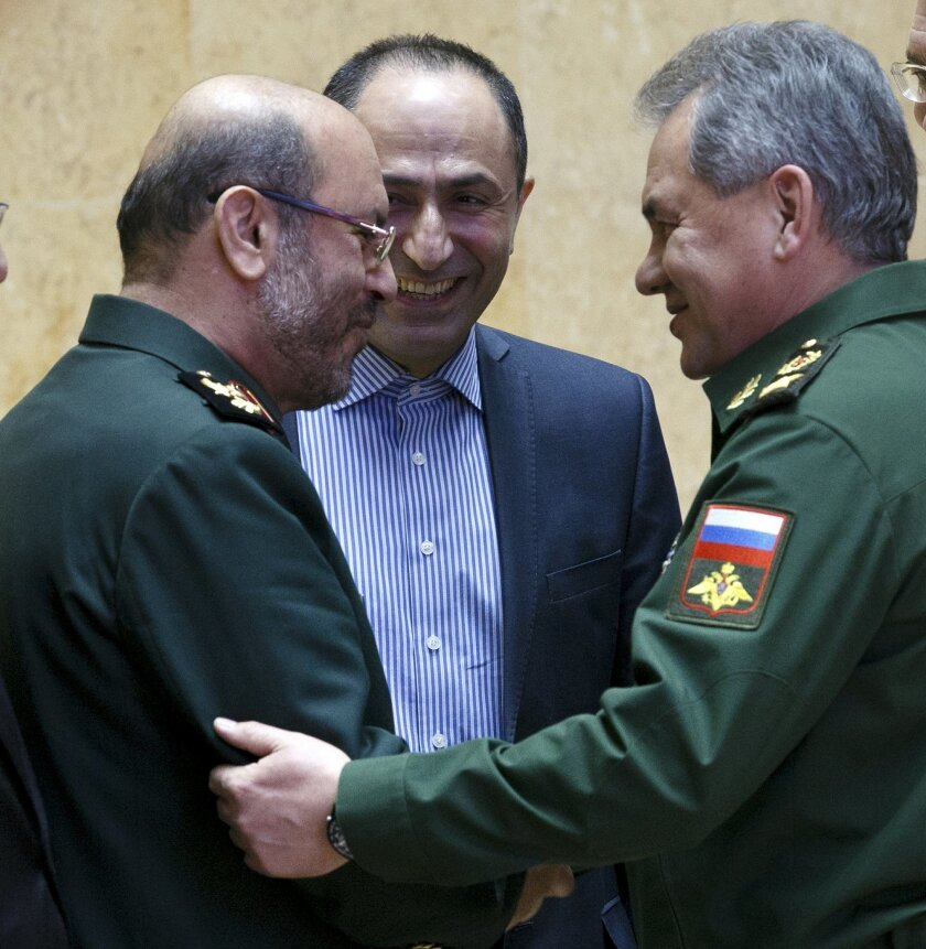 Russian Defense Minister Sergei Shoigu, right, and Iranian Defense Minister Hossein Dehghan shake hands during their meeting in Moscow, Russia, Tuesday, Feb. 16, 2016.  The Iranian defense minister is visiting Moscow for talks about closer military cooperation. (Vadim Savitsky/ Russian Defense Mini