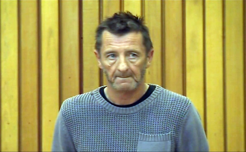 AC/DC drummer Phil Rudd in Tauranga District Court in New Zealand. Authorities have dropped the murder-for-hire charge against Rudd.