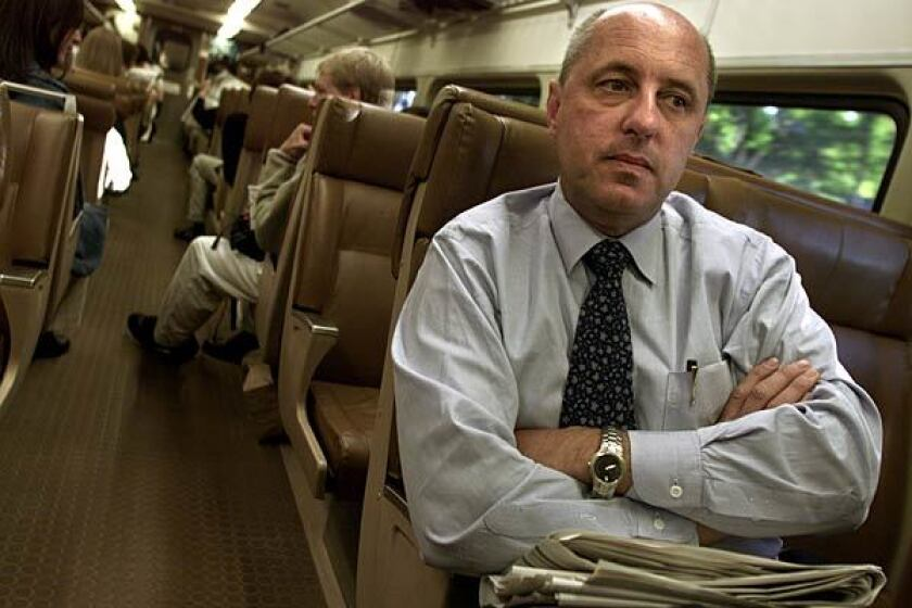 "Walter Pilipiak rides the commuter train, heading for borrowed office space. ""We are New Yorkers, and we will survive,"" he told his parent firm last week. ""We are just lucky, lucky to be here."""