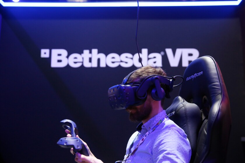 LOS ANGELES, CA-JUNE 12, 2019: Scott Hayden interacts with a Bethesda VR experience during the annua