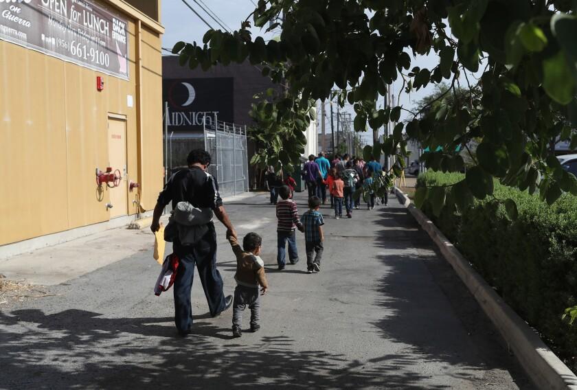 Central American migrant families depart U.S. custody  in McAllen, Texas, in 2018 pending future immigration court hearings.