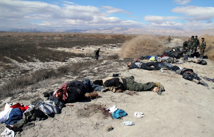 A photo released by the official Syrian Arab News Agency reportedly shows the corpses of dozens of rebel fighters who state media and a monitoring group said were killed Wednesday in an army ambush in the eastern Ghouta area outside Damascus.