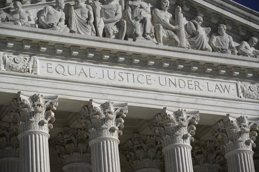 """A closeup of the pediment of a building with the words """"Equal justice under law."""""""