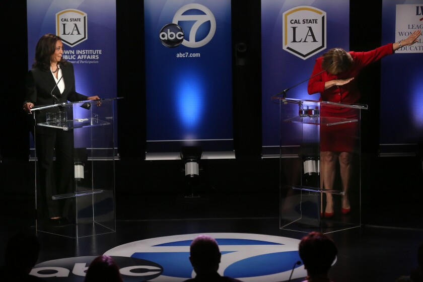 U.S. Senate candidate and California Attorney General Kamala Harris watches as her opponent Rep. Loretta Sanchez dabs at the end of her closing statement during their one and only debate at California State University, Los Angeles.