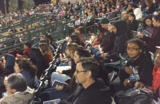 People attend vigil for shooting victims at San Manuel Stadium in San Bernardino