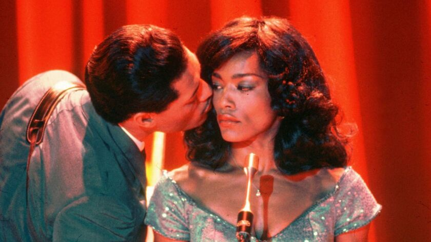 """Laurence Fishburne and Angela Bassett in the movie """"What's Love Got to Do With It."""""""