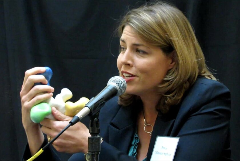 """Ebola expert Erica Ollmann Saphire of The Scripps Research Institute holds a model of ZMapp, a three-antibody """"cocktail"""" that has been shown to neutralize Ebola in animal studies. ZMapp has been given to Ebola patients as an emergency measure, but has not yet been tested in clinical trials for humans."""