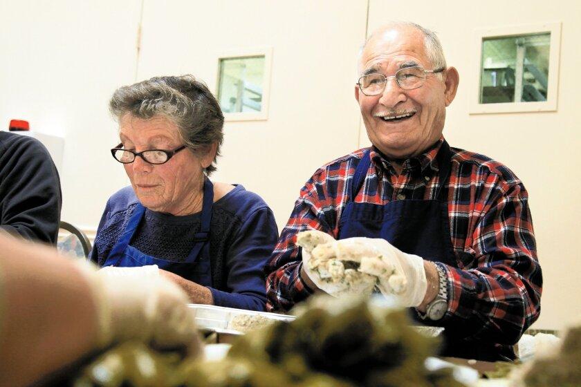 Angeliki Smirniotis, 77, and her husband, Dimitri Smirniotis, 80, were among volunteers preparing countless dolmades for the church festival.