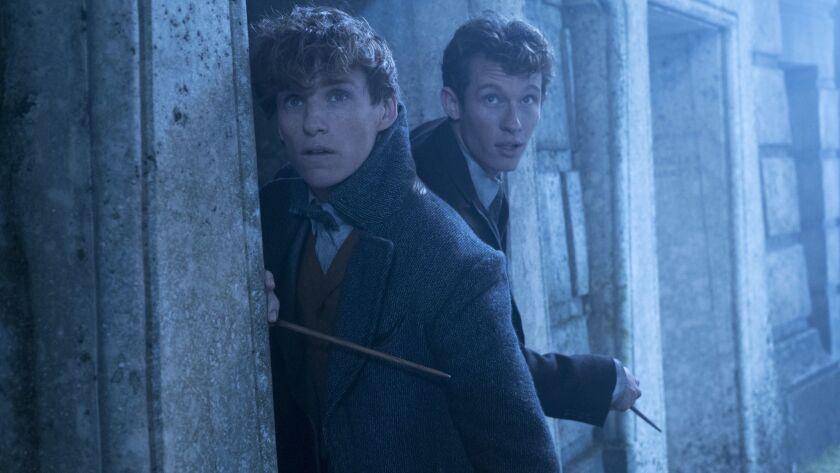 "Eddie Redmayne, left, as Newt Scamander and Callum Turner as Theseus Scamander in the fantasy adventure ""Fantastic Beasts: The Crimes of Grindelwald."""