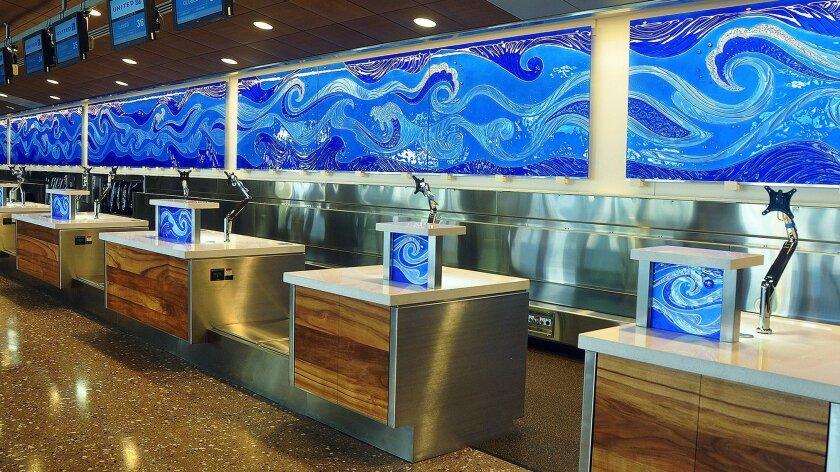 A commercial project created by Cast Glass Images is a wave-themed glass installation at Honolulu International Airport.