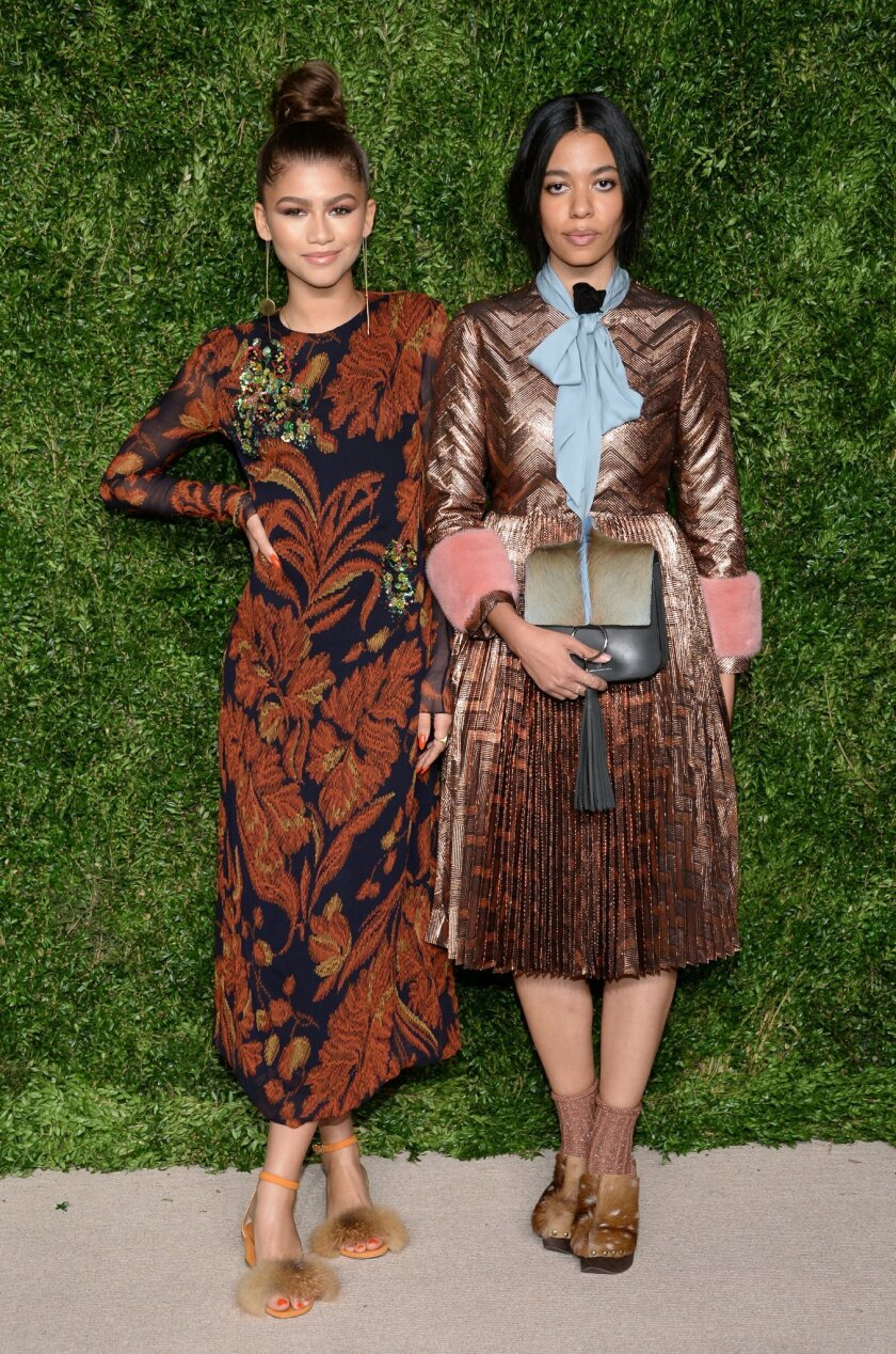 FILE - In this Nov. 2, 2015 file photo, singer Zendaya, left, and designer Aurora James, of Brother Vellies, attends the 12th Annual CFDA/Vogue Fashion Fund Awards at Spring Studios in New York. (Photo by Evan Agostini/Invision/AP, File)