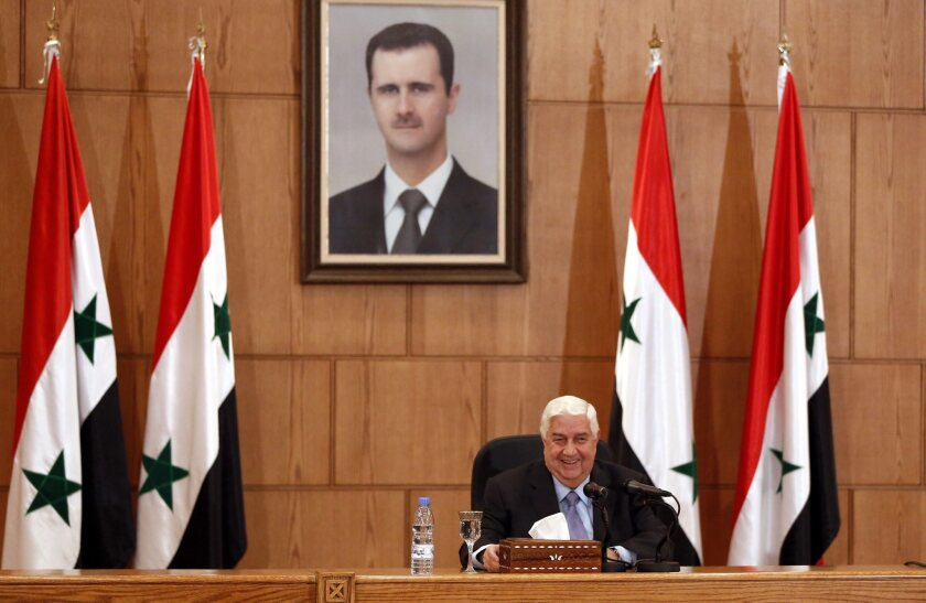 Syrian Foreign Minister Walid Moallem addresses a news conference in Damascus.