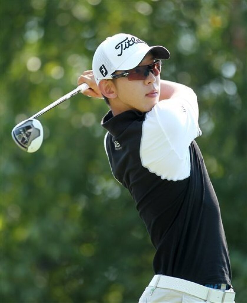 Seung-Yul Noh, from South Korea, hits his tee shot on the tenth hole during the first round of the Deutsche Bank Championship PGA golf tournament at TPC Boston in Norton, Mass., Friday, Aug. 31, 2012. (AP Photo/Stew Milne)