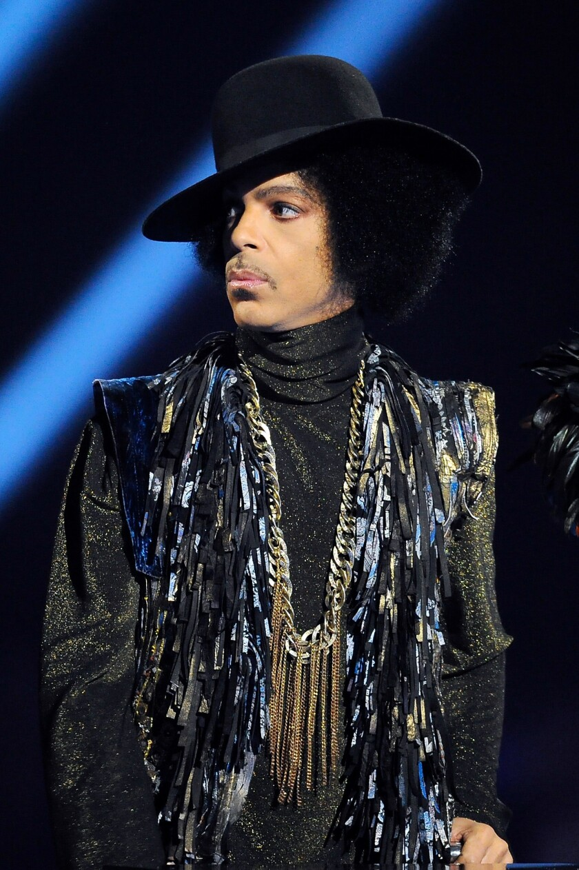 Prince presents the award for British Female Solo Artist at The BRIT Awards 2014 at 02 Arena on February 19, 2014 in London.