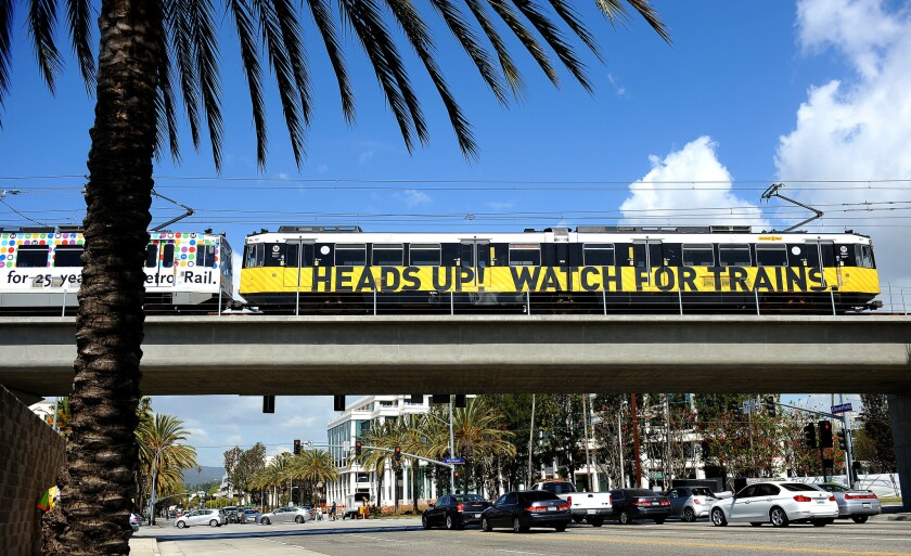 A train rides over a bridge to the 26th Street/Bergamot station in Santa Monica.
