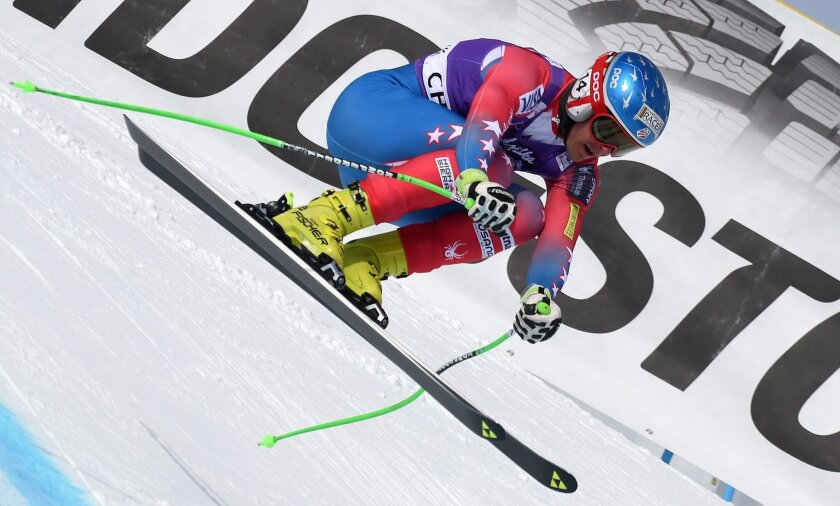 Steven Nyman, of the United States, speeds down the slope during an Alpine ski, men's downhill training, in Chamonix, France, Thursday, Feb. 18, 2016. (AP Photo/Pier Marco Tacca)