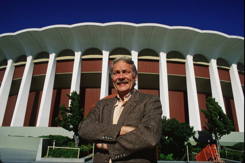 Lakers owner Jerry Buss stands outside the Forum in 1990.