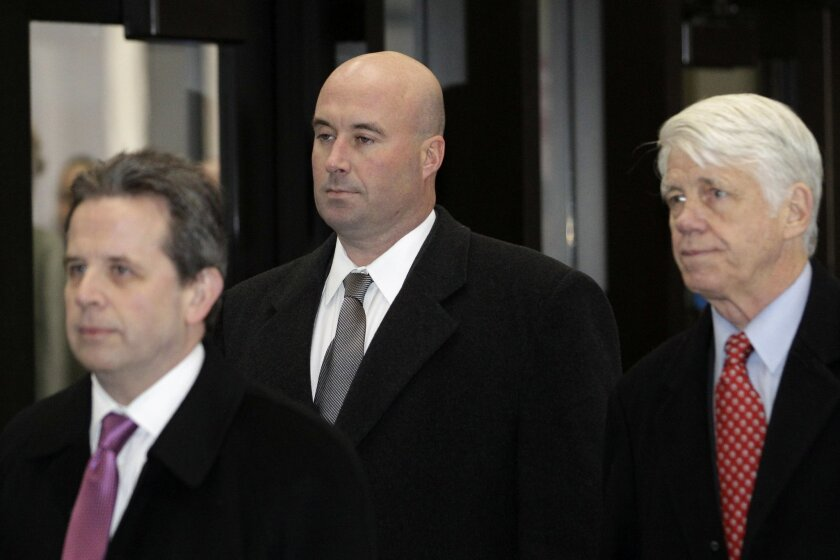 FILE - In this Dec. 10, 2012 file photo, Richard Vanecko, nephew of former Chicago Mayor Richard Daley, center, accompanied by attorneys Mark Martin, left, and Tom Breen, arrives at the Leighton Criminal Courts Building in Chicago for his arraignment on involuntary manslaughter charges. On Friday,
