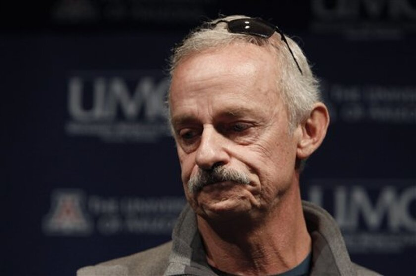 Bill Heilman, husband of injured shooting victim Susan Heilman, pauses as he describes his reaction after he found out his wife had been shot and Christina Green, 9, who was with his wife at the time had died in the shooting, during a news briefing at University Medical Center, Tuesday, Jan. 11, 2011, in Tucson, Ariz. Rep. Gabrielle Giffords, D-Ariz., who is still in critical condition, and other victims who were shot on Saturday, leaving six dead and more injured. (AP Photo/Ross D. Franklin)