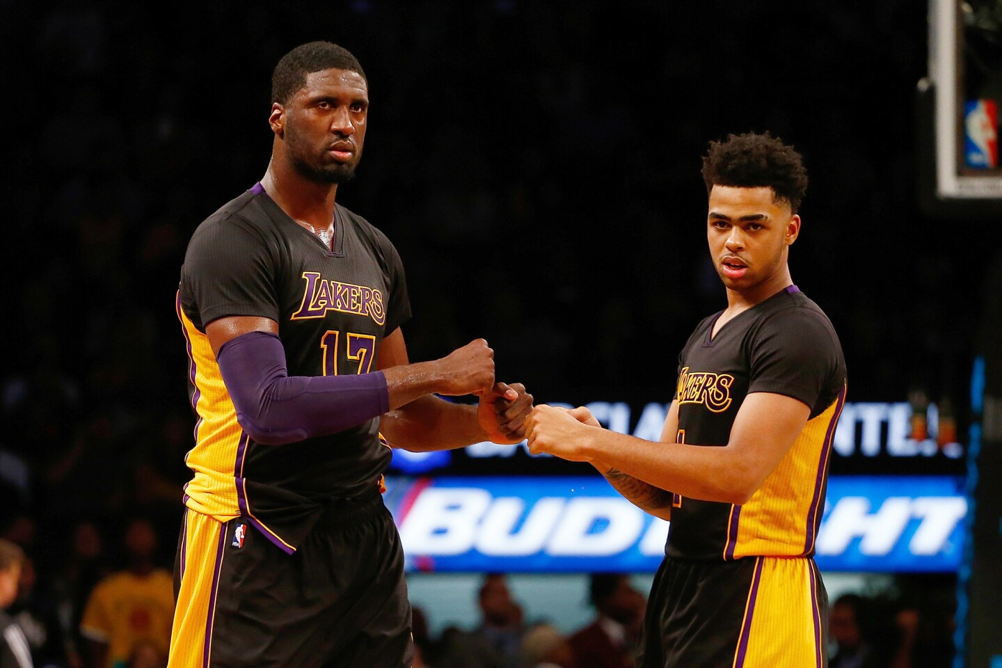 Lakers guard D'Angelo Russell and center Roy Hibbert (17) celebrate during a game against the Brooklyn Nets on on Nov. 6.