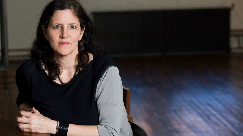 In this April 16, 2014 file photo, documentary filmmaker Laura Poitras poses for a portrait in New Y