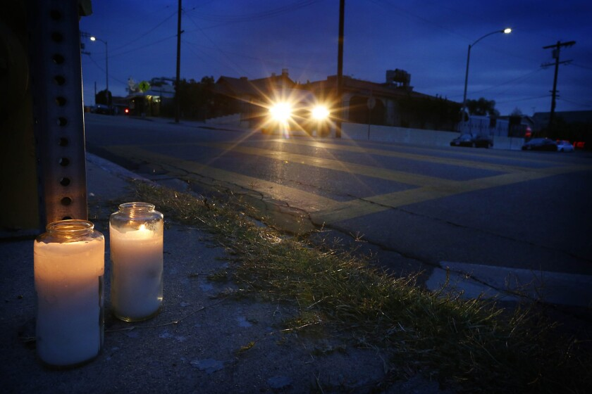Candles mark the crosswalk in Boyle Heights where Raquel Diaz, a nun, was critically injured when she was struck by a hit-and-run driver. Diaz died Sunday.