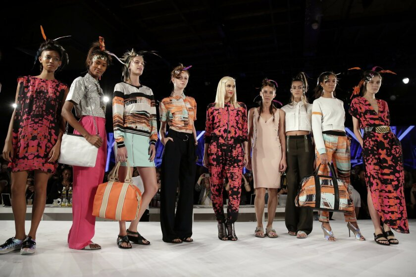 Gwen Stefani, center, poses with models during the finale of the L.A.M.B. Spring 2015 collection presentation, during Fashion Week in New York, Friday, Sept. 5, 2014. (AP Photo/Richard Drew)