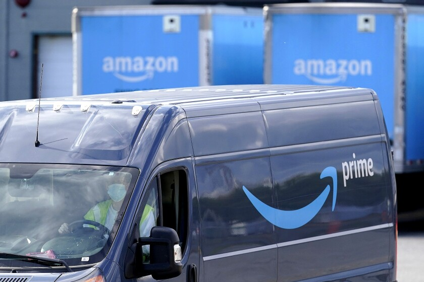 An Amazon Prime logo appears on the side of a delivery van as it departs an Amazon Warehouse location, Thursday, Oct. 1, 2020, in Dedham, Mass. Halloween is still weeks away, but retailers are hoping you'll start your holiday shopping now. The big push is coming from Amazon, which is holding its annual Prime Day sales event Tuesday, Oct. 13 and Wednesday, Oct. 14. (AP Photo/Steven Senne)
