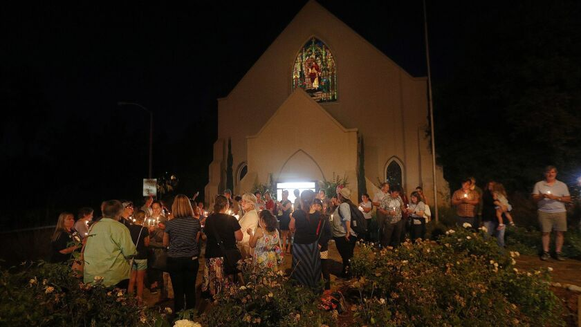Participants gather in front of the at the La Cañada Congregational Church at a candlelight vigil for the Lights for Liberty event on Friday. The Nationwide Vigil to End Human Detention Camps had about 85 people participating locally.