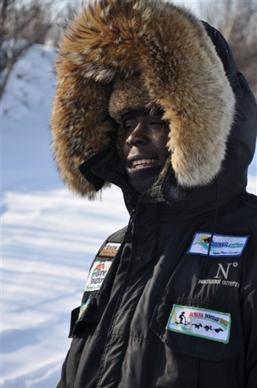 This Feb. 2009 picture provided by Eppo Eerkes shows Newton Marshall in a parka on the Yukon Quest Trail near Fairbanks, Alaska. The creators of the Jamaica Dogsled Team are sending Marshall to the pinnacle of world-class competitions, the 1,100-mile Iditarod Trail Sled Dog Race. (AP Photo/Eppo Eerkes)