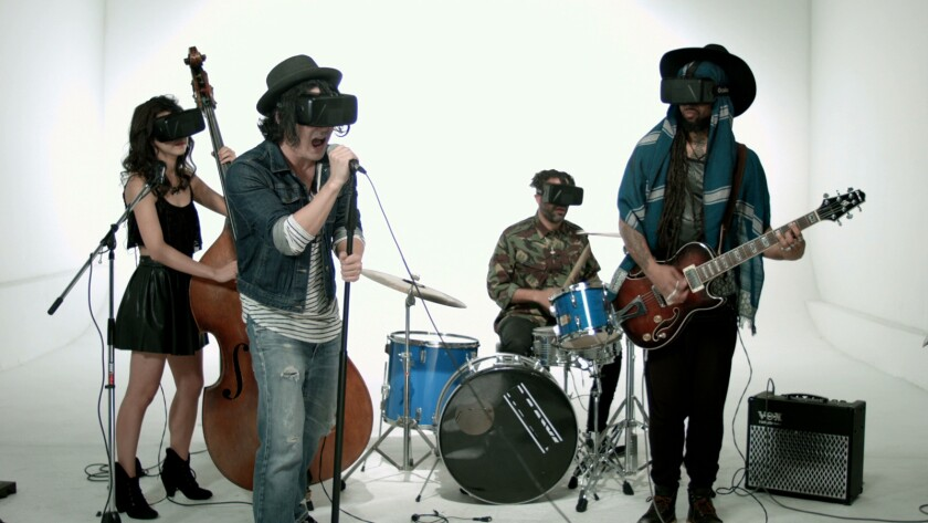 The band Sheeppsyche performs wearing virtual reality goggles in the movie 'Ximbi Xombix'