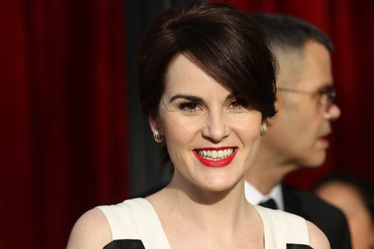 """""""I was listening to Beyonce's new album nonstop this morning while getting ready,"""" the """"Downton Abbey"""" actress, sporting a structured black and white gown with a plunging neckline. """"That album is everything I want in life. It's brilliant."""" Dockery's cheerfulness is a stark contrast from that of her character's this season. When the fourth season of """"Downton Abbey"""" picked up earlier this month, it had been six months since the death of Mary's husband, and downton heir, Matthew. """"Matthew is a tough one to beat,"""" Dockery said. """"He was the love of [my character's] life. I think [creator Julian Fellowes] is taking every character on an interesting journey."""""""