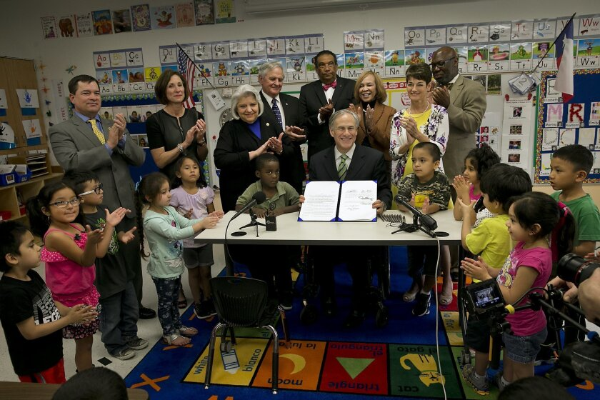 """FILE - In this May 28, 2015, file photo, Texas Gov. Greg Abbott poses for a photo after signing into law a pre-K boost that was among his top campaign promises but has underwhelmed educators in Austin, Texas. Abbott's cornerstone education plan that tea party activists rebuked as """"ungodly"""" and Demo"""